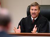 Prince William County (Virginia) Judge LeRoy Millett Jr., gestures as he speaks to attorneys during the trial of sniper suspect John Allen Muhammad, at the Virginia Beach Circuit Court  in Virginia Beach, Virginia on October 24, 2003.  <br /> Credit: Davis Turner - Pool via CNP