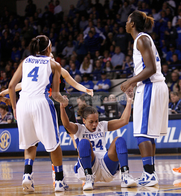 UK guard Keyla Snowden (4) and forward Samarie Walker (23) help up teammate point guard Amber Smith (24) during the first half of the UK Women's basketball game against Florida on 1/22/12 at Memorial Coliseum in Lexington, Ky. Photo by Quianna Lige | Staff