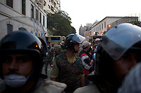 Members of the Egyptian National Army block a street near Tahrir Square in an attempt to prevent clashes between protestors and security forces.
