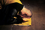 00558_ 20; Footsteps of Buddha; Kyoto, Japan, 2004; JAPAN-10002. A Buddhist monk prays.