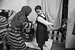 29.1.2015 Kirkuk,Iraq.  Widad giving a hand to her niece (Asma) to prepare before going to school.