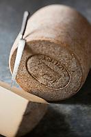 Europe/France/Auvergne/12/Aveyron/Laguiole: Caves  Fourme de Laguiole - AOC Laguiole  - Coopérative  Jeune Montagne  -  Appellation d'Origine Protégée - Chaque pièce est marquée du sceau du taureau - Stylisme : Valérie LHOMME //   France, Aveyron, Laguiole, Fourme Caves de Laguiole Laguiole AOC Cooperative Young Mountain Protected Designation of Origin Each piece stamped with the seal of the bull Styling, Valerie Lhomme