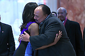 Omarosa Manigault  (l) greets Martin Luther King III (r) as he arrives in the lobby of the Trump Tower in New York, NY, on January 16, 2017.<br /> Credit: Anthony Behar / Pool via CNP