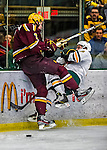 24 November 2012: University of Vermont Catamount forward Pete Massar, a Junior from Williston, VT, collides with defenseman Brady Skjei, a Freshman from Lakeville, MN, in first period action against the University of Minnesota Golden Gophers at Gutterson Fieldhouse in Burlington, Vermont. The Catamounts fell to the Gophers 3-1 in the second game of their 2-game non-divisional weekend series. Mandatory Credit: Ed Wolfstein Photo