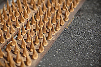 Handmade sandalwood incense drives in the sun on the street side.