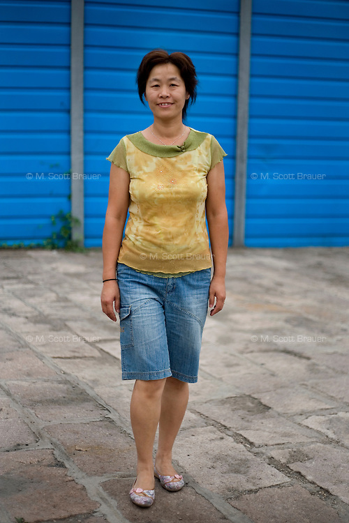 Gaohonghu, a teacher, age 40, poses for a portrait in Badaling. Response to 'What does China mean to you?': 'That's just what it means.'  Response to 'What is your role in China's future?': 'I want to become a peaceful protector.'