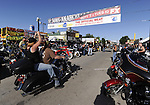 STURGIS, SOUTH DAKOTA - AUGUST 2010:  Motorcyclists ride on Main Street in downtown Sturgis, South Dakota while attending the 70th annual Sturgis Motorcycle Rally held in the Black Hills.  The attendance estimates were placed between 500, 000 and 700,000 bikers.
