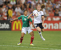 Rachel Buehler (19) of the USWNT goes against Stephany Mayor (16) of Mexico. The USWNT defeated Mexico 7-0 during an international friendly, at RFK Stadium, Tuesday September 3, 2013.