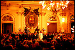 In the ballroom of Casa Rosada President Duhalde is sworn in while members of the Legislative Assembly stand up and sing the national anthem. President Duhalde promised in a short but vigorous inauguration speech that he would negotiate Argentina's foreign debt and rid the government of it's corruption and political favoritism.