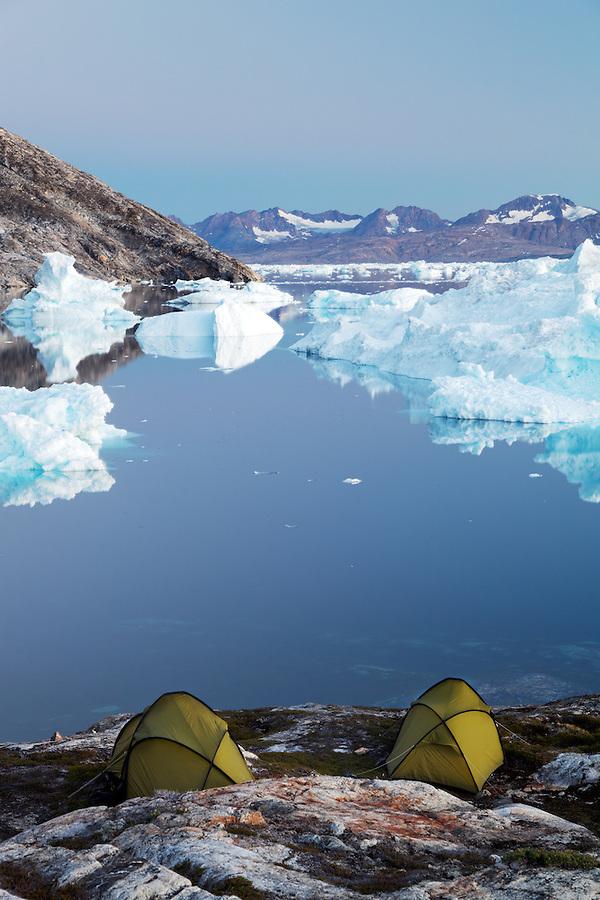 Icebergs and sea kayaker's camp on edge of Sermilik Fjord near settlement of Tiniteqilaq, East Greenland