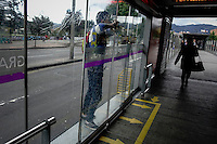 A man accesses illegally and unsafely to the massive public transportation know as TRANSMILENIO in Bogota, Colombia.  05/15/2015. Eduardo MunozAlvarez/VIEWpress