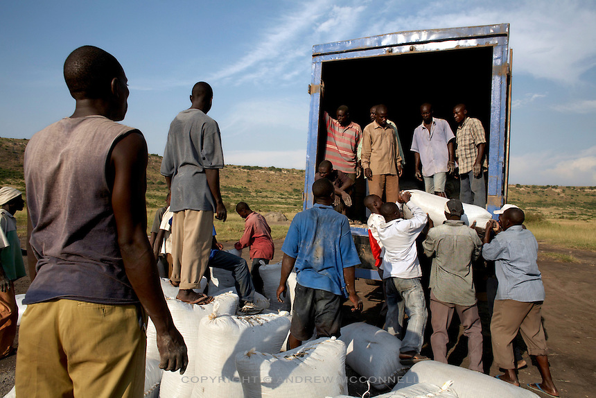 100 kg sacks of salt are loaded onto a waiting truck at Lake Katwe, Uganda. The transportation of salt increases its price dramatically and salt from Katwe is transported all over the region.