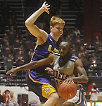 "Ole Miss guard Chris Warren (12)  is fouled by Louisiana State's Eddie Ludwig (13) at the C.M. ""Tad"" Smith Coliseum in Oxford, Miss. on Wednesday, February 9, 2011. Ole Miss won 66-60 and is now 4-5 in the Southeastern Conference."