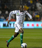 Chicago midfielder Patrick Nyarko (14) dribbles the ball toward the Houston goal.  The Chicago Fire defeated the Houston Dynamo 2-0 at Toyota Park in Bridgeview, IL on April 24, 2010.