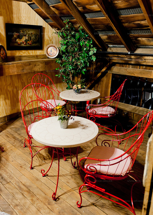 A cozy seating area is reserved for wine club members, in the rafters above the tasting room at Aspen Dale Winery.