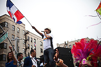 """Dominican personality know as 'El pacha"""" takes part during the Bronx Dominican parade in New York July 28, 2013 by Kena Betancur / VIEWpress"""