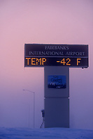 Outdoor temperature sign at the Fairbanks International Airport reads minus 42 degrees on a cold winter day, Fairbanks, Alaska