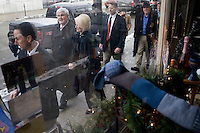 Flanked by a security detail, Newt and Callista Gingrich walk to businesses in downtown Littleton, New Hampshire.  Newt Gingrich, former Speaker of the House, is seeking the 2012 Republican nomination for president.