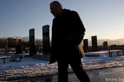 Vitali Kaloyev at the graveyard of his wife and children in Vladikavkaz, in North Ossetia in southern Russia. .The 52-year-old architect, who killed the air traffic controller blamed for the plane crash in which he lost his wife and two children, is being treated as a national hero..Kaloyev, who was freed November 2007 from a Swiss jail after serving less than four years, was appointed deputy construction minister for his home region..Kaloyev was building a holiday villa in Spain for a wealthy Russian when his wife Svetlana, 44, 10-year-old son Konstantin and four-year-old daughter Diana, set out to join him for a holiday in July 2002. As their plane flew over Germany it collided with a cargo jet killing all 71 people on board, most of them Russian schoolchildren..Investigators later established that Peter Nielsen, a Dane working for Skyguide, the Swiss air-traffic control service at Zurich airport, was the only person on duty. He had panicked when he realised the two planes were on a collision course and gave wrong instructions to the pilots..Like other bereaved relatives, Kaloyev grew angry at the slow pace of the investigation and the way Skyguide, fearful of lawsuits, sought to place the blame on others..Kaloyev claims he cannot remember what happened next, but does not deny stabbing Nielsen several times with a pocket knife. Nielsen bled to death before an ambulance could reach him. Kaloyev was arrested the following day and was sentenced to eight years for manslaughter.