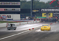 Aug 30, 2014; Clermont, IN, USA; NHRA pro mod driver Troy Coughlin (right) races alongside Steven Whiteley during qualifying for the US Nationals at Lucas Oil Raceway. Mandatory Credit: Mark J. Rebilas-USA TODAY Sports