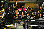 20 February 2009: The University of Vermont Catamount pep band plays behind protective netting at a game against the University of Massachusetts River Hawks at Gutterson Fieldhouse in Burlington, Vermont. The teams battled to a 3-3 tie. Mandatory Photo Credit: Ed Wolfstein Photo