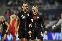 USWNT midfielders Lauren Cheney (12), Amy Rodriguez(8)..in the wall.....USWNT played to a 1-1 tie with Canada at LIVESTRONG Sporting Park, Kansas City, Kansas.