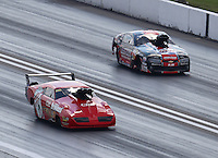 Sep 24, 2016; Madison, IL, USA; NHRA pro mod driver Peter Farber (left) races alongside Mike Janis during qualifying for the Midwest Nationals at Gateway Motorsports Park. Mandatory Credit: Mark J. Rebilas-USA TODAY Sports