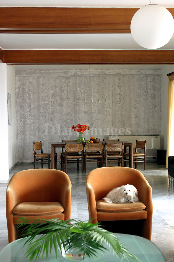 contemporary living room<br /> <br /> A house on the fifth floor of an apartment building with distinctive architecture from the 70s and decorated minimally in order to highlight the design of the house.