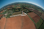 Aerial view of the Shenandoah Valley looking east from south of Harrisonburg, Virginia. Farmland on the valley floor, with mountains in the background.