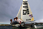 Training Session with the 18 feet skiff Slam sailed by Grant Rollerson along with experienced crew members Anthony (Jack) Young and Peter Nicholson in Sydney Harbour..The 18ft Skiff is considered the fastest class of sailing skiffs. The class has a long history beginning with races on Sydney Harbour, Australia in 1892. It is the fastest conventional non-foiling monohull on the yardstick rating.