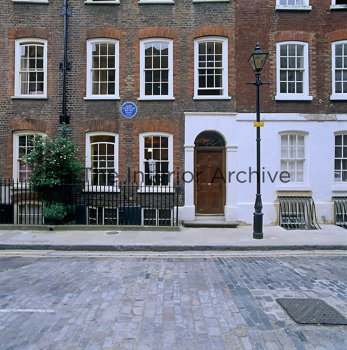 A blue plaque commemorates an historic house in London once lived in by the painter Mark Gertler