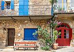 Colorful façades of houses brighten a street in Saint-Cyprien, Périgord Noir, France.