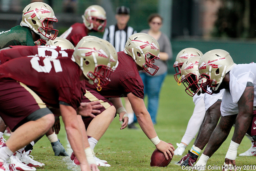 TALLAHASSEE, FL 8/7/12-FSU080712 CH-Florida State center Austin Barron prepares to snap the ball during practice Aug. 7 in Tallahassee. .COLIN HACKLEY PHOTO