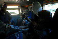 Filipino men check their knives for protection against bandits while riding in a jeepney in Ilocos Norte, Philippines..**For more information contact Kevin German at kevin@kevingerman.com