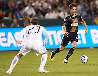 Philadelphia Union midfielder Stefani Miglioranzi (6) attempts to navigate around LA Galaxy midfielder David Beckham (23). The LA Galaxy defeated the Philadelphia Union 1-0 at Home Depot Center stadium in Carson, California on  April  2, 2011....