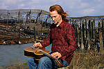 Pat Wictor playing slide guitar along the Hudson River, NYC. 12/23/02.