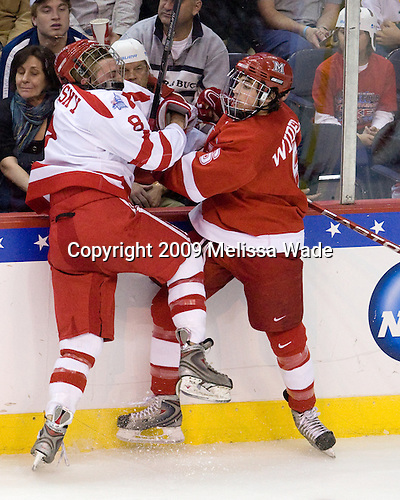 Steve Smolinsky (BU - 8), Chris Wideman (Miami - 6) - The Boston University Terriers defeated the Miami University RedHawks 4-3 in overtime to win the 2009 NCAA D1 National Championship at the Frozen Four on Saturday, April 11, 2009, at the Verizon Center in Washington, DC.
