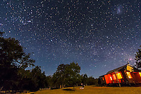 Orion, Sirius, Canopus and the southern Milky Way over Timor Cottage at Coonabarbran, NSW, Australia, December 18, 2012. The LMC is above right. Taken in moonlight from waxing crescent Moon. A single 75-second exposure with Canon 60Da at ISO 1600 and 10-22mm lens at f/4.