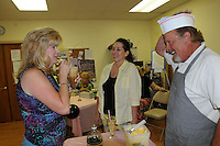 NWA Democrat-Gazette/ FLIP PUTTHOFF<br /> ICE CREAM TREATS<br /> Pam Harrington (from left) and Tracy Fortuny sip root beer floats served up by Ken Dickerson on Saturday June 13 2015 during an ice-cream social fundraiser at Unity Church of the Ozarks in Bentonville. The social had a 1950s theme and raised funds for the church, said Claudia Lawson, church member. Art items made by church members were sold in a silent auction to benefit the church, located at 902 S.W. 2nd St.