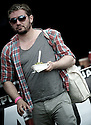 Plastic pub drink, take away food, cotton bag, ray ban, horizontal stripes t-shirt and a wristband. It's a festival day outfit.