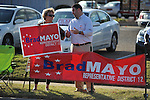 Jane Windham (left) and candidate Brad Mayo campaign outside the voting booths at the old National Guard Armory in Oxford, Miss. on Tuesday, November 8, 2011. Mississippians go to the polls today for state and local elections, as well as referendums including the so-called Personhood Amendment.