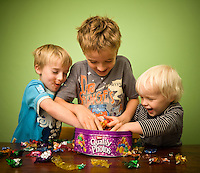 The boys grab as many chocolates as they can!