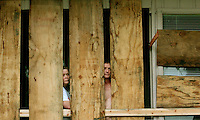 DAPHNE, ALA 8/29/05-Melissa Butts and Mark Turley watch Hurricane Katrina come ashore from the safety of their Sea Cliff condominium unit, Monday in Daphne, Ala. COLIN HACKLEY PHOTO