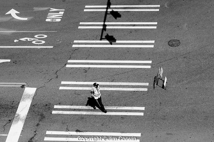 Police directing traffic walking in crosswalk