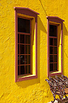 A brightly painted yellow wall catches the eye.