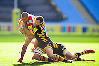 Mike Brown of Harlequins is tackled to ground by Jimmy Gopperth of Wasps. Aviva Premiership match, between Wasps and Harlequins on October 2, 2016 at the Ricoh Arena in Coventry, England. Photo by: Patrick Khachfe / JMP