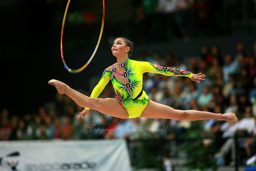 Alina Kabaeva of Russia straddle jumps with hoop during event finals at 2007 Portimao World Cup of Rhythmic Gymnastics on April 29, 2006.  (Photo by Tom Theobald)..