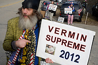 Occupy presidential candidate Vermin Supreme speaks to the media outside a Romney campaign event to begin at Gilchrist Metal Fabricating in Hudson, New Hampshire, on Jan. 9, 2012.  Romney is seeking the 2012 Republican presidential nomination.