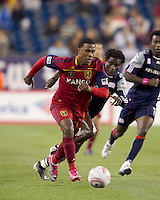 Real Salt Lake forward Robbie Findley (10) on the attack with New England Revolution defender Emmanuel Osei (5) closing. Real Salt Lake defeated the New England Revolution, 2-1, at Gillette Stadium on October 2, 2010.