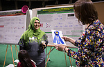 Sazan Ismael receives a first place ribbon for her work at the student expo on April 6, 2017.